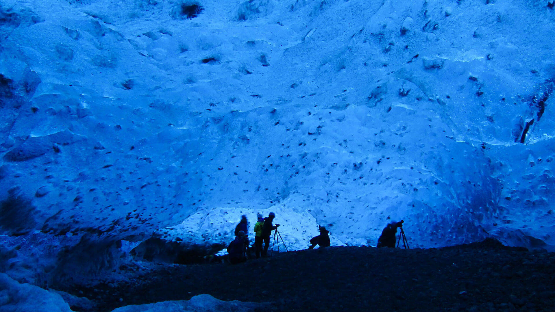 People photographing in Icecave, in Vatnajokull