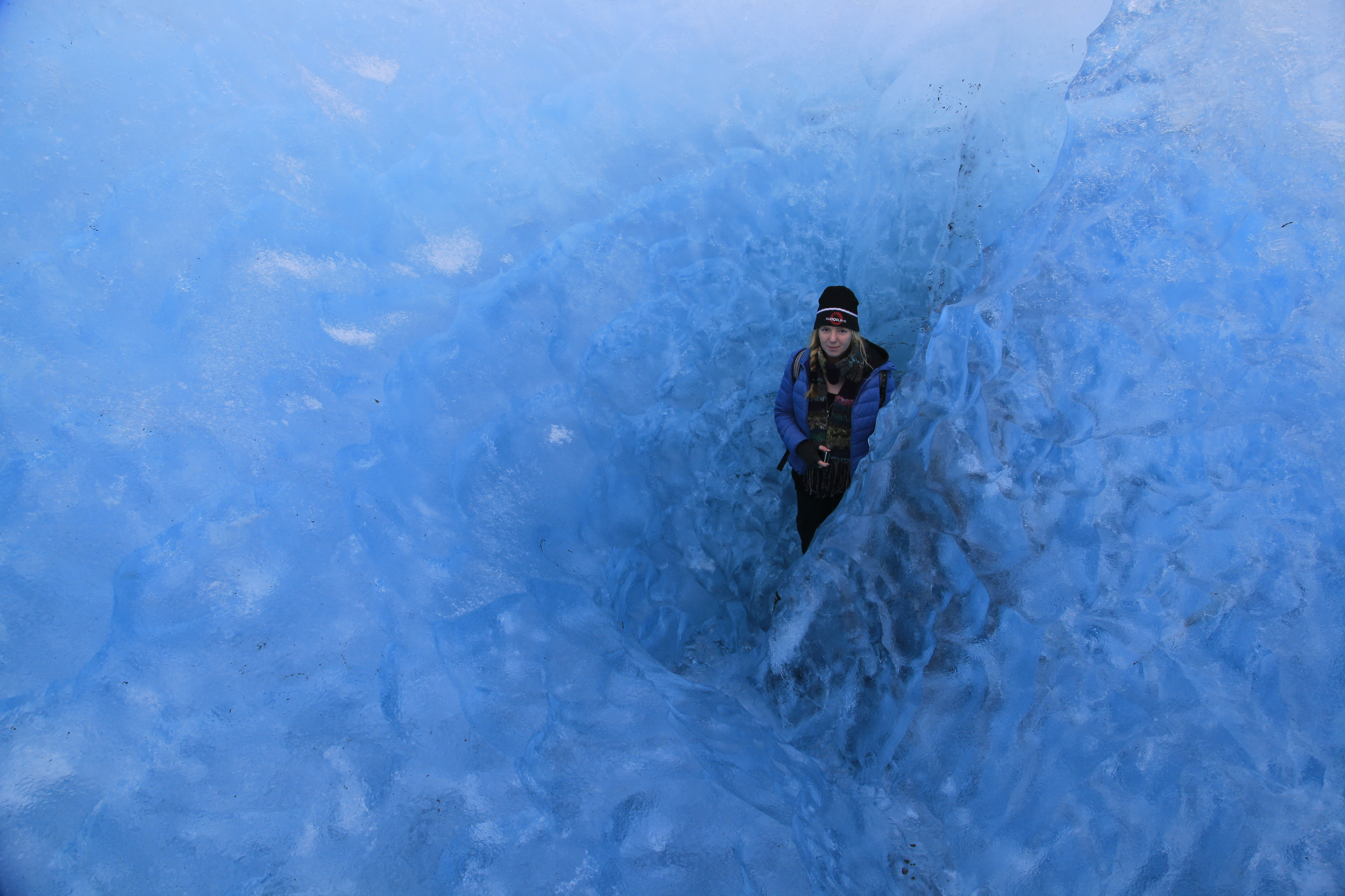 Blue Iceland - Ice Caving and Hiking tour - Guest in blue ice on Vatnajökull, Iceland.