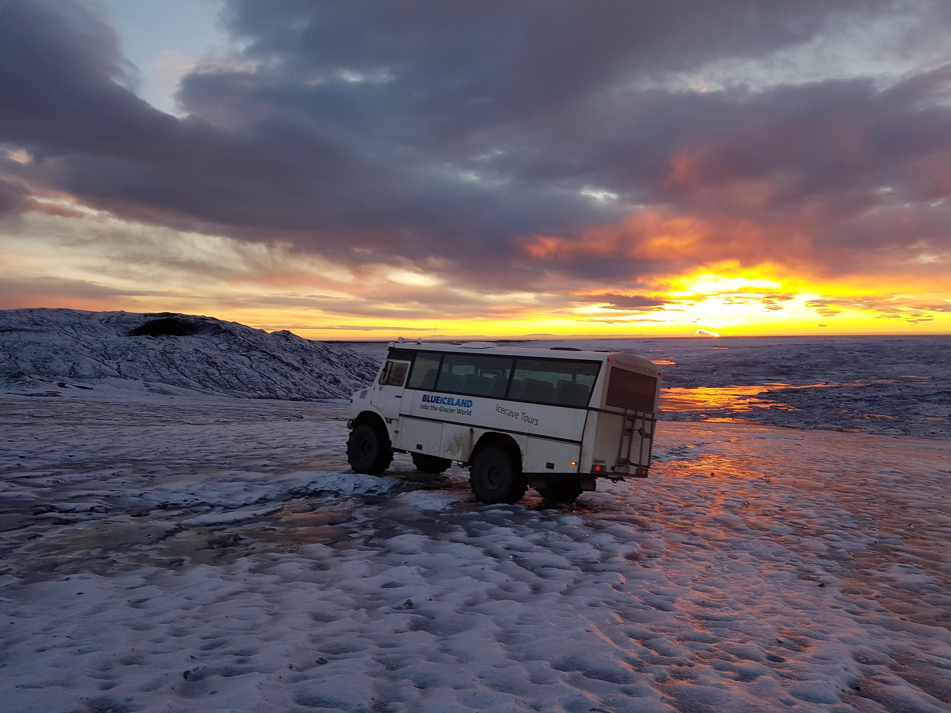 Blue Iceland glacier tour - sunset on Vatnajökull - Unimog glacier vehicle.